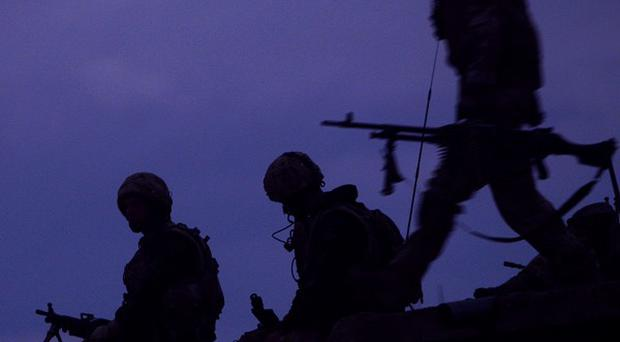 Seven Royal Marines have been arrested over allegations of a murder in Afghanistan last year