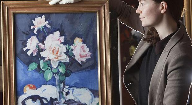 Pink Roses by renowned Scottish Colourist Samuel Peploe is expected to fetch up to £300,000 at auction later this month (PA)