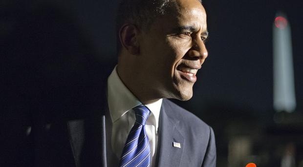 A shot was fired through the window of President Barack Obama's Denver campaign office (AP/J Scott Applewhite)