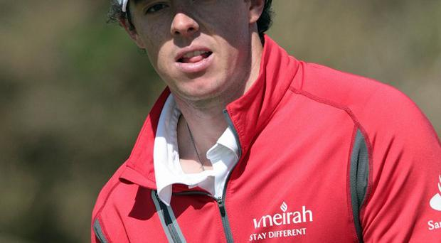 Rory McIlroy, pictured, lost by six shots to Tiger Woods