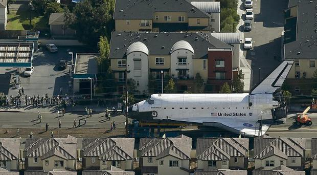 The space shuttle Endeavour makes its way down Manchester Boulevard in Los Angeles (AP)