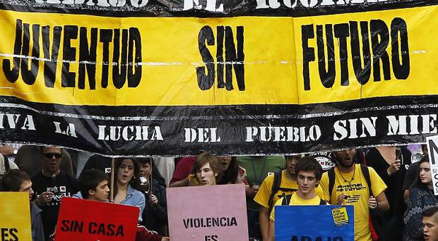 Protestors in Madrid march against austerity measures announced by the Spanish government (AP)