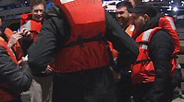 Some of the 22 rescued passengers on the pier in San Francisco (AP/KTVU-TV)