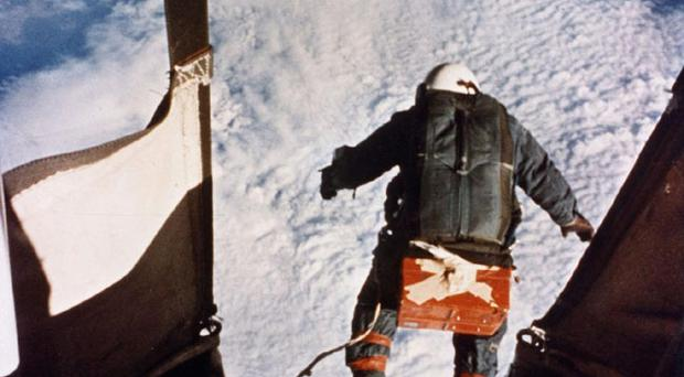FILE - In this Aug. 16, 1960, file photo provided by the U.S. Air Force, Col. Joe Kittinger steps off a balloon-supported gondola at an altitude of 102,800 feet. In freefall for 4.5 minutes at speeds up to 614 mph and temperatures as low as -94 degrees Fahrenheit, he opened his parachute at 18,000 feet. On Tuesday, Oct. 9, 2012, if winds allow, in the desert surrounding Roswell, N.M., pilot Felix Baumgartner will attempt to break Kittinger's world record for the highest and fastest free fall. (AP Photo/U.S. Air Force, File)