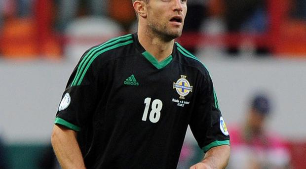 Aaron Hughes, pictured, is expecting a tough battle against Cristiano Ronaldo on Tuesday