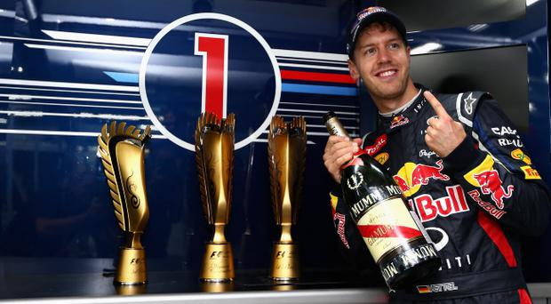 YEONGAM-GUN, SOUTH KOREA - OCTOBER 14: Sebastian Vettel of Germany and Red Bull Racing celebrates in his team garage after winning the Korean Formula One Grand Prix at the Korea International Circuit on October 14, 2012 in Yeongam-gun, South Korea. (Photo by Clive Mason/Getty Images)