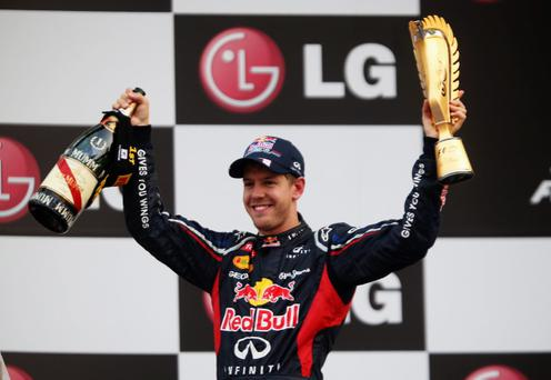 YEONGAM-GUN, SOUTH KOREA - OCTOBER 14: Sebastian Vettel of Germany and Red Bull Racing celebrates on the podium after winning the Korean Formula One Grand Prix at the Korea International Circuit on October 14, 2012 in Yeongam-gun, South Korea. (Photo by Mark Thompson/Getty Images)