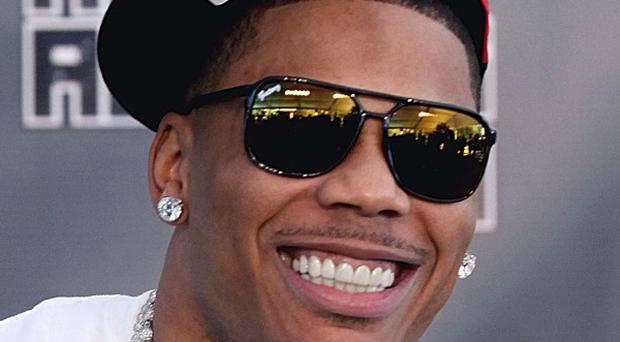 Drugs and a gun were allegedly found on rapper Nelly's tour bus at a West Texas border checkpoint