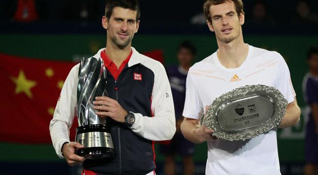 Novak Djokovic of Serbia, left, and Andy Murray of Britain, right, pose for photos during their award ceremony of the men's singles at the Shanghai Masters tennis tournament at Qizhong Forest Sports City Tennis Center in Shanghai, China, Sunday Oct. 14, 2012. Djokovic won 5-7, 7-6(11), 6-3. (AP Photo/Eugene Hoshiko)