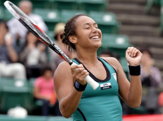 Heather Watson of Britain reacts after beating Taiwan's Chang Kai-Chen 7-5, 5-7, 7-6 (4) in their final match at the Japan Open women's tennis tournament in Osaka, western Japan, Sunday, Oct. 14, 2012. Watson became the first British woman in 24 years to win a WTA title. (AP Photo/Kyodo News) JAPAN OUT, MANDATORY CREDIT, NO LICENSING IN CHINA, FRANCE, HONG KONG, JAPAN AND SOUTH KOREA
