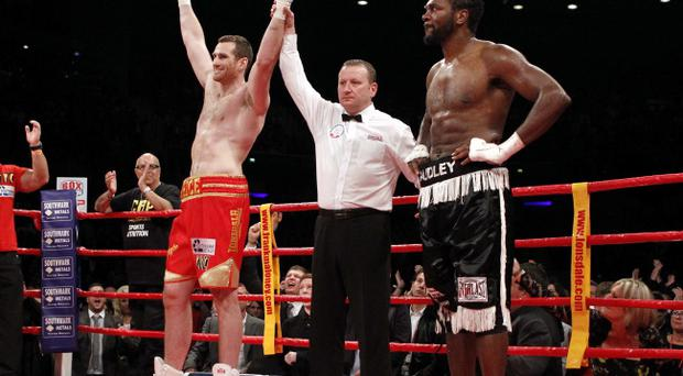 David Price and Audley Harrison react after The British Heavyweight and Commonwealth Titles Fight at the Liverpool Echo Arena