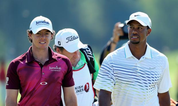 ANTALYA, TURKEY - OCTOBER 11: Tiger Woods of the USA looks at Rory McIlroy of Northern Ireland as they walk off the 18th green together on day three of the Turkish Airlines World Golf Final at the Antalya GC on October 11, 2012 in Antalya, Turkey. (Photo by Warren Little/Getty Images)
