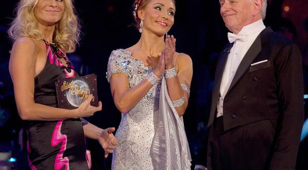 Just over eight million people watched Johnny Ball and partner Iveta Lukosiute being voted off Strictly Come Dancing, hosted by Tess Daly (left)