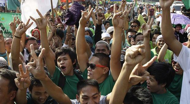 Filipino Muslims celebrate after hearing news of the signing of a preliminary peace pact (AP)