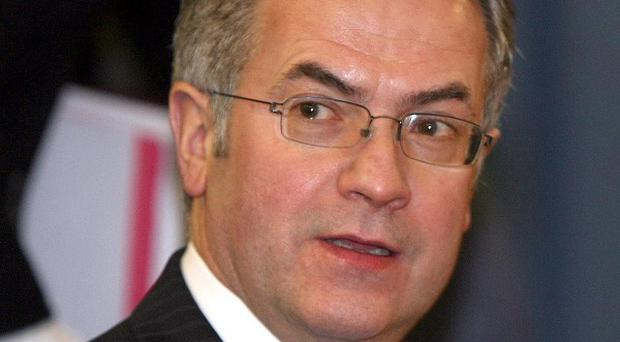 Environment Minister Alex Attwood said disposing of fuel laundering waste was a 'significant drain on resources'