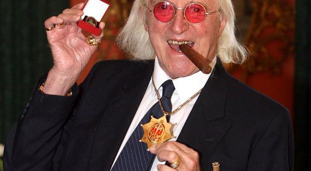 Labour has called for an independent inquiry into Jimmy Savile's activities at the BBC, Stoke Mandeville Hospital and Broadmoor