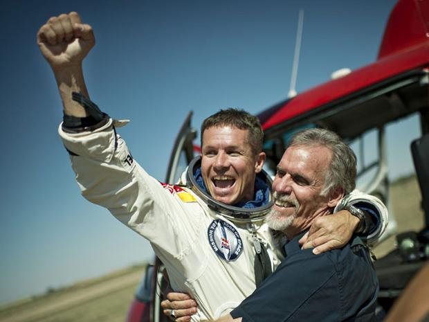 ROSWELL, NM - OCTOBER 14: (NO SALES/NO ARCHIVE) Pilot Felix Baumgartner of Austria and Technical Project Director Art Thompson (R) of the Unites States celebrate after successfully completing the final manned flight for Red Bull Stratos on October 14, 2012 in Roswell, New Mexico. Austrian Felix Baumgartner broke the world record for the highest free fall in history after making a 23-mile ascent in capsule attached to a massive balloon. (Photo by Joerg Mitter/Red Bull Stratos via Getty Images)