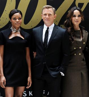 Cast members Naomie Harris, left, Daniel Craig and Berenice Marlohe pose together during a photo call for the new James Bond film