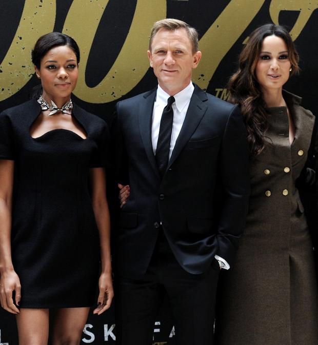 "Cast members Naomie Harris, left, Daniel Craig and Berenice Marlohe pose together during a photo call for the new James Bond film ""Skyfall"" at the Crosby Street Hotel on Monday Oct. 15, 2012 in New York."