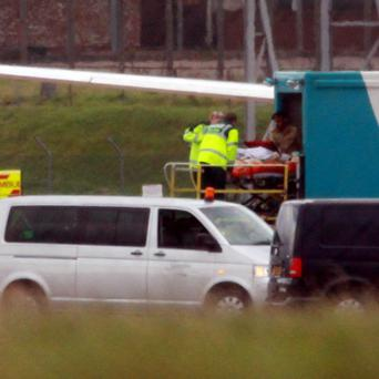 Malala Yousafzai, 14, the Pakistani schoolgirl shot in the head by Taliban gunmen arrives in the UK at Birmingham Airport