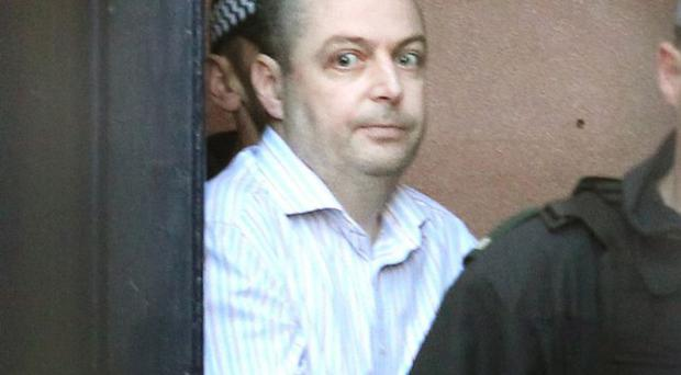 Christopher O'Kane at Londonderry court on Monday where he was charged with terrorism offences in connection to the murder of RUC Constable Michael Ferguson