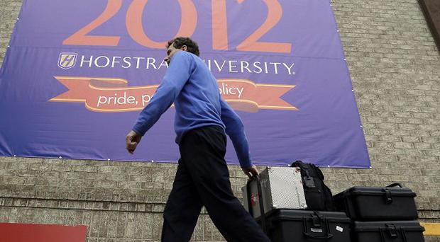 President Barack Obama and Republican candidate Mitt Romney will face-off at at Hofstra University in Hempstead, New York (AP/Charlie Neibergall)