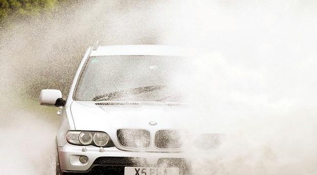 Motorists have been warned to take extra care as heavy rainfall is expected to flood roads