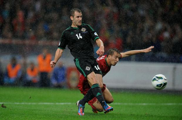 Northern Ireland's Niall McGinn scores the opening goal during the World Cup Group F Qualifying match at the Estadio do Dragao, Porto, Portugal. PRESS ASSOCIATION Photo. Picture date: Tuesday October 16, 2012. See PA story SOCCER N Ireland. Photo credit should read: Andrew Matthews/PA Wire.