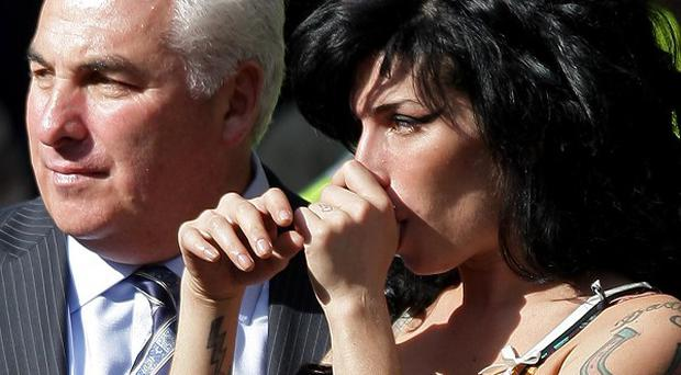 The late Amy Winehouse with her father Mitch, who is backing a new anti-drugs campaign