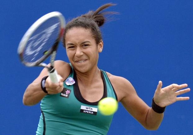 Heather Watson of Britain returns a shot against Chang Kai-Chen of Taiwan during their women's final match at Japan Women's Open tennis tournament in Osaka, western Japan, Sunday, Oct. 14, 2012. Watson won the final 7-5, 5-7, 7-6(4). (AP Photo/Kyodo News) JAPAN OUT, MANDATORY CREDIT, NO LICENSING IN CHINA, FRANCE, HONG KONG, JAPAN AND SOUTH KOREA