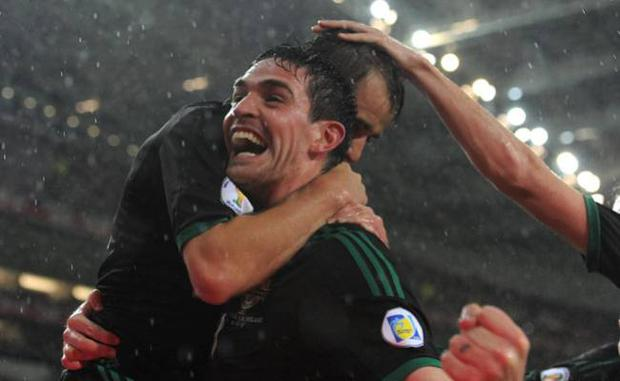 Northern ireland's Niall McGinn celebrates with team mate Kyle Lafferty (centre) after scoring during the World Cup Group F Qualifying match at the Estadio do Dragao, Porto, Portugal.