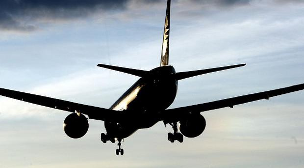 A man who tried to open an emergency exit after a flight landed in the US is due in court