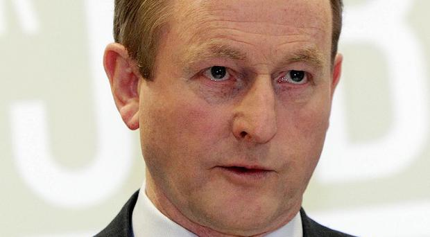 Campaigners want Enda Kenny to apologise for what they say was inaction by the Republic of Ireland's government during the Troubles