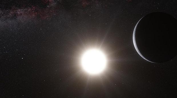 An artist's impression of the newly-discovered planet orbiting Alpha Centauri B, one of the Sun's closest neighbours (PA/University of Geneva)