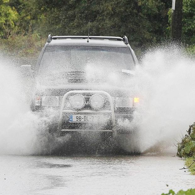 Garda have urged drivers to 'exercise extreme caution' after heavy rain cause localised flooding