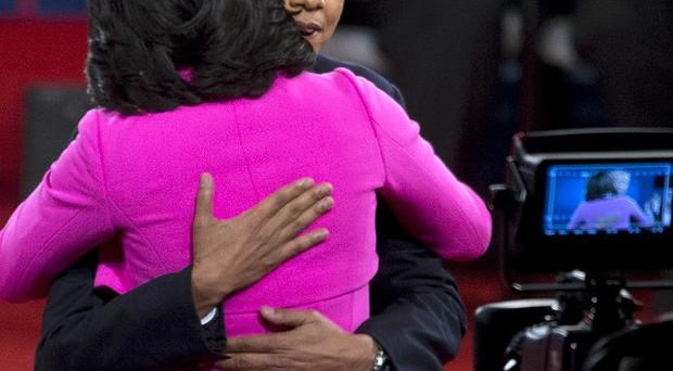 President Barack Obama embraces first lady Michelle Obama after the second presidential debate (AP/Carolyn Kaster)