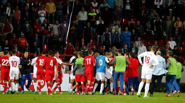 KRUSEVAC, SERBIA - OCTOBER 16: Players of Serbia and England clash after the Under 21 European Championship Play Off second leg match between Serbia U21 and England U21 at Stadium Mladost on October 16, 2012 in Krusevac, Serbia. (Photo by Srdjan Stevanovic/Getty Images)