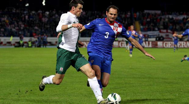 Wales' Gareth Bale (left) is fouled by Croatia's Josip Simunic during the World Cup Group A Qualifying match at the Stadion Gradski vrt, Osijek, Croatia. PRESS ASSOCIATION Photo. Picture date: Tuesday October 16, 2012. See PA story SOCCER Wales. Photo credit should read: Nick Potts/PA Wire.
