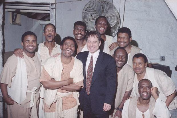 Joseph Shabalala, founder of South Africa's Ladysmith Black Mambazo being embraced by Paul Simon