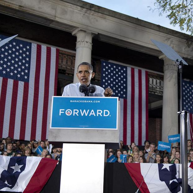 US President Barack Obama is said to be planning an election-night rally in his hometown of Chicago (AP)