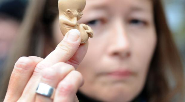 Pacemaker Press 18/10/2012: Anti Abortion Protesters outside the Marie Stopes private clinic in Belfast