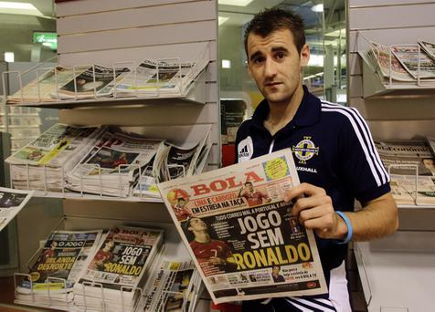 Niall McGinn enjoys flicking through the papers in Porto