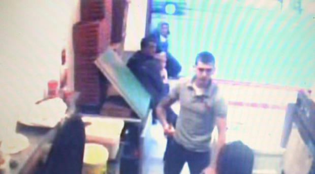 Footage in Bella Milano Chip Shop in the New Lodge, Belfast showing a man lifting a knife, threatening and then punching Moe Mustafa.