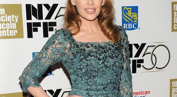 Kylie Minogue says she faces reminders of her cancer battle every day