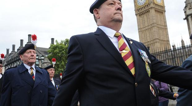 Veterans of the Royal Regiment of Fusiliers join a Westminster demonstration against the Government's decision to disband a battalion