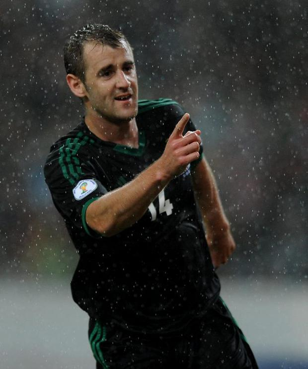 Northern Ireland's Niall McGinn celebrates scoring during the World Cup Group F Qualifying match at the Estadio do Dragao, Porto, Portugal.