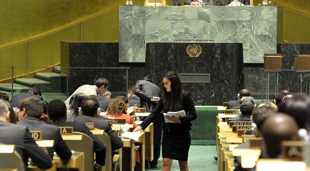 Ballots are distributed as the UN General Assembly prepares to elect five new non-permanent members of the UN Security Council (AP)