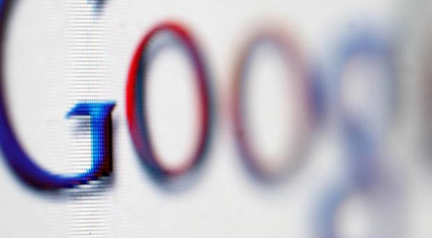 Google's revenue rose 18 per cent, excluding this year's acquisition of Motorola Mobility