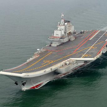 Chinese aircraft carrier Liaoning cruises for a test on the sea (AP/Xinhua, Li Tang)