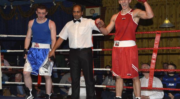 Matthew McCafferty celebrates his victory over Pearce Knocker in the middleweight final of the Antrim intermediate championships in the Dockers Club